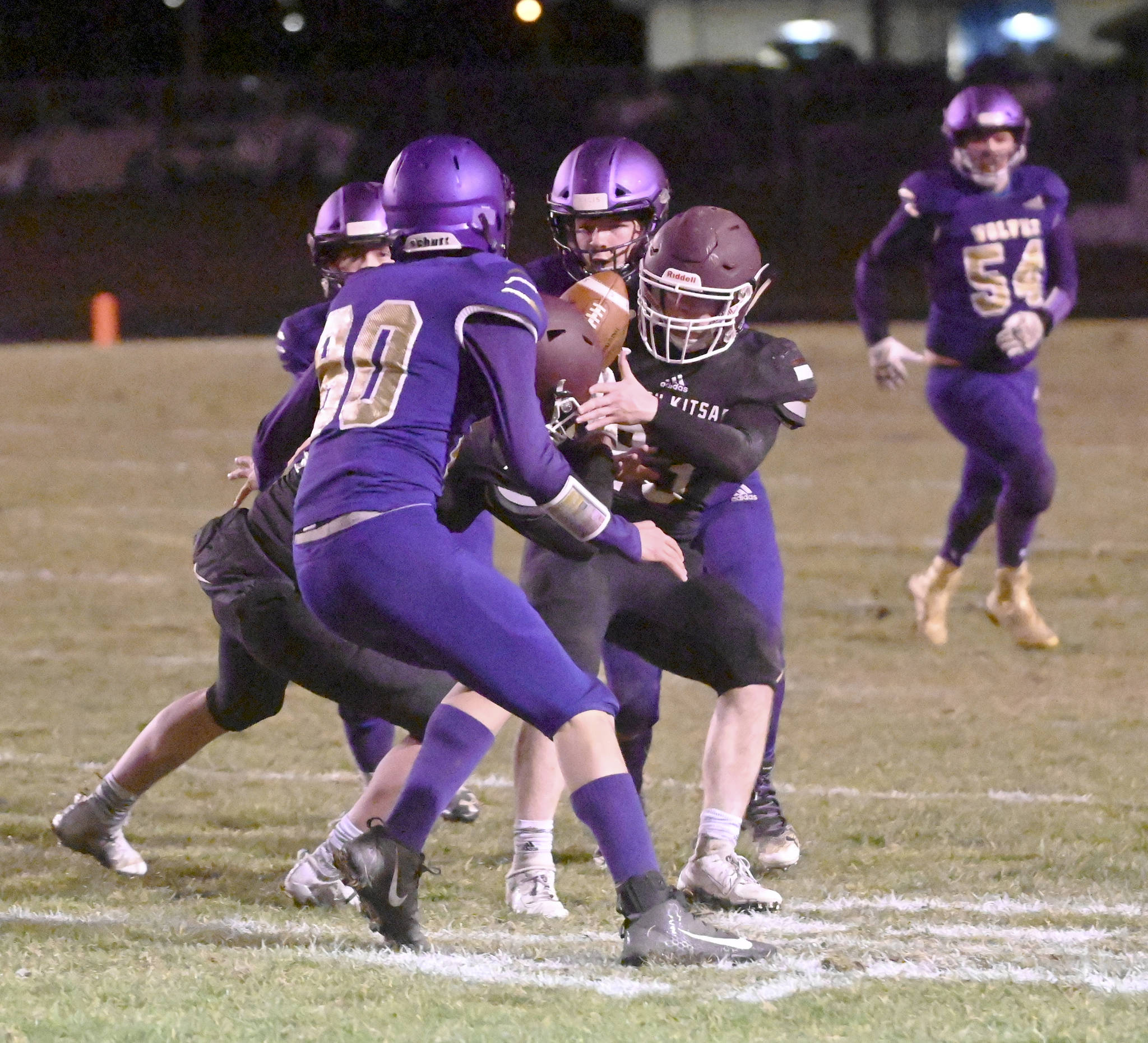 South Kitsap receiver Brayden Segerman tries to get his hands on a pass while surrounded by Sequim defenders. (Michael Dashiell/Sequim Gazette)
