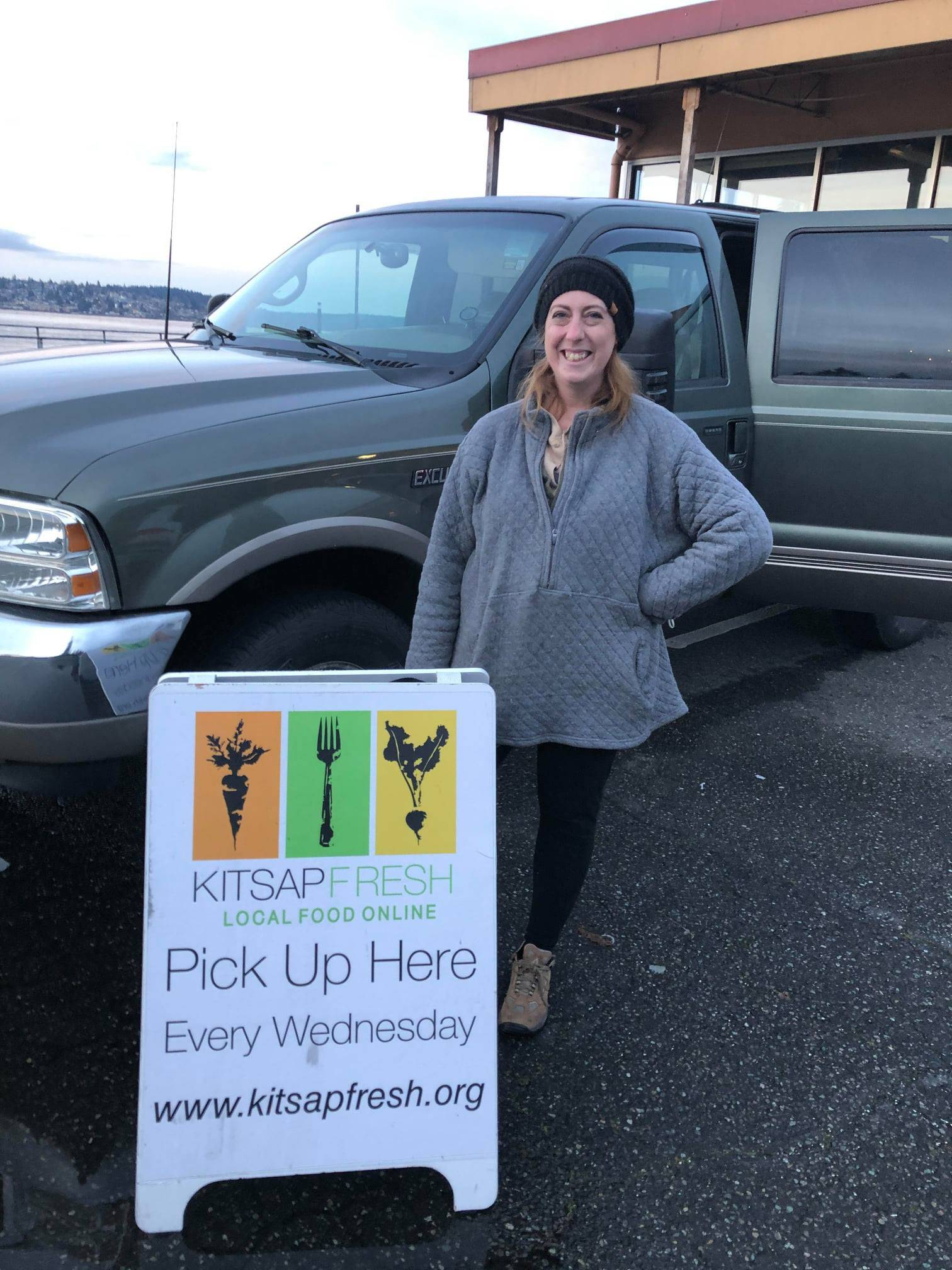 Elleni Mendoza poses at one of Kitsap Fresh's pickup locations in Poulsbo.(courtesy photo)